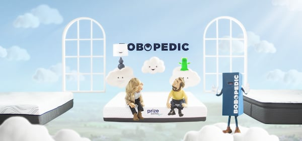 Little Bob puppet and woman puppet sitting on a Bob-O-Pedic mattress with clouds floating overhead